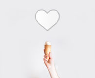 Hand with ice cream on background of hearts, Concept of 8 March,. Valentine`s Day, Women`s , love Royalty Free Stock Image