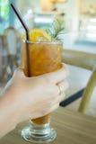 Hand on iced lemon tea Royalty Free Stock Photography