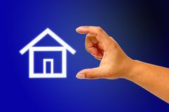 Hand and icon house Stock Image