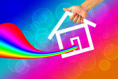 Hand and icon house Royalty Free Stock Photo