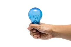Hand of Idea. A hand holding a blue lightbulb Stock Photos