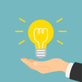 Hand with idea light bulb. Royalty Free Stock Photography