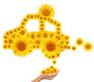 Hand idea with sunflower eco car image. Stock Photography