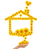 Hand idea with sunflower home image. Royalty Free Stock Image