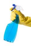 Hand im Handschuh mit Sprayflasche Stockfotografie