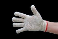 Hand im Sicherheitshandschuh Stockfoto