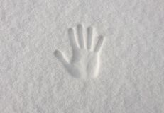 Hand impression in fresh snow Stock Images