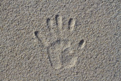Hand imprint. On the sand Stock Photo