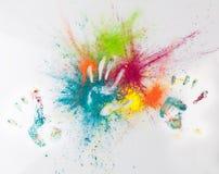 Hand imprints in Holi powder. Happy Holi concept. Stock Photos