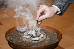 Hand by incense Stock Image