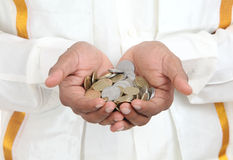 Hand with Indian rupee coins Stock Photo