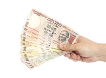Hand with Indian thousand rupee notes Royalty Free Stock Images