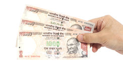 Hand with Indian thousand rupee notes Stock Photography