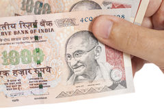 Hand with Indian thousand rupee notes Royalty Free Stock Photography