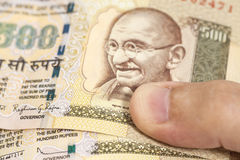 Hand with Indian thousand rupee notes Royalty Free Stock Photos