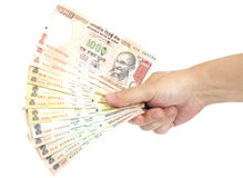 Hand with Indian thousand rupee notes Royalty Free Stock Photo