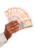 Hand with Indian thousand rupees Royalty Free Stock Image