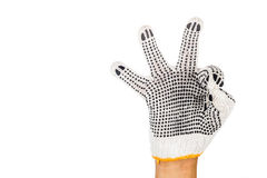 Hand in industrial glove gesturing OKAY against white background Royalty Free Stock Photos
