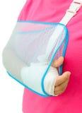 Hand injury. With white medicine bandage wearing hand sling Royalty Free Stock Photos