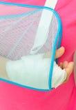 Hand injury. With white medicine bandage wearing hand sling Stock Image