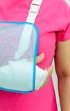 Hand injury. With white medicine bandage wearing hand sling Royalty Free Stock Images