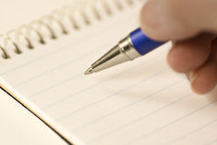 Hand With Ink Pen royalty free stock photo