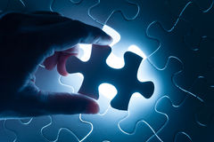 Hand insert jigsaw, conceptual image of business Royalty Free Stock Photos