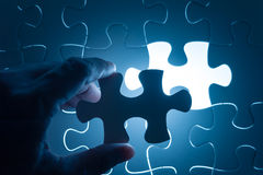 Hand insert jigsaw, conceptual image of business Royalty Free Stock Images