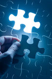 Hand insert jigsaw, conceptual image of business Stock Image