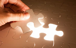 Hand insert jigsaw, conceptual image of business Stock Photography