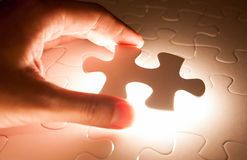 Hand insert jigsaw, conceptual image of business Royalty Free Stock Image