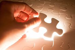 Hand insert jigsaw, conceptual image of business Stock Photo