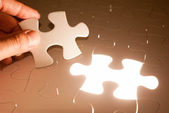 Hand insert jigsaw, conceptual image of business Royalty Free Stock Photography