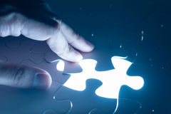 Hand insert jigsaw, conceptual image of business strategy Royalty Free Stock Photography