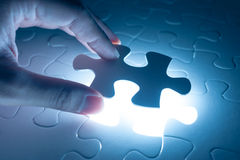 Hand insert jigsaw, conceptual image of business strategy Royalty Free Stock Photos