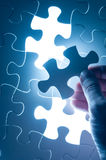 Hand insert jigsaw, conceptual image of business strategy, decis Royalty Free Stock Photos
