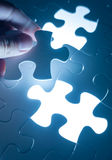 Hand insert jigsaw, conceptual image of business strategy, decis. Ion making concept Royalty Free Stock Photography