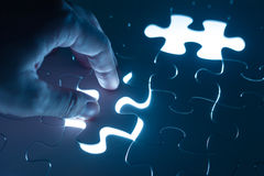 Hand insert jigsaw, conceptual image of business strategy Royalty Free Stock Images