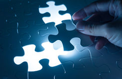 Hand insert jigsaw, conceptual image of business strategy Royalty Free Stock Image