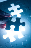Hand insert jigsaw, conceptual image of business strategy Stock Image