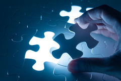 Hand insert jigsaw, conceptual image of business strategy Stock Photography