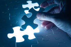 Hand insert jigsaw, conceptual image of business strategy Royalty Free Stock Photo