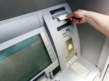 Hand inserting ATM card into bank machine to withdraw money.  Royalty Free Stock Photography