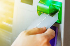 Hand inserting ATM card into bank machine to withdraw money,Hand Royalty Free Stock Photography