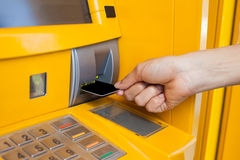 Hand inserting card into cash machine Royalty Free Stock Images