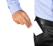 Hand inserting card in pocket. Isolated on white background professionally Stock Photography