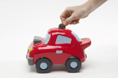Hand Inserting Coin In Toy Car Stock Photography