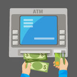 Hand inserting credit card into grey ATM and withdrawing money. Hand inserting green credit card into grey ATM and withdrawing money. Process of getting cash Stock Images