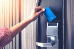 Hand inserting key card to unlock a door security authentication in the hotel or apartment safeguard.  royalty free stock images