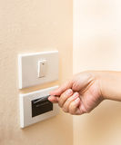A hand inserting keycard in the electronic lock Stock Photography